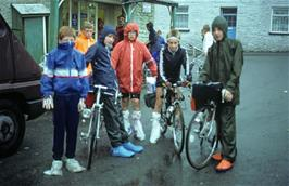 The youngsters outside the grocery store in Llanddewi Brefi, displaying the latest fashion in waterproof overshoes courtesy of the shopkeeper's wife
