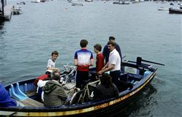 Three members leave Salcombe on the first of four boat journeys to East Portlemouth