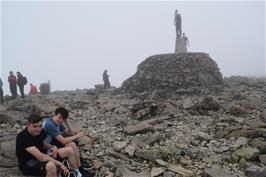 Waiting our turn to stand on the trig point on Ben Nevis Cairn